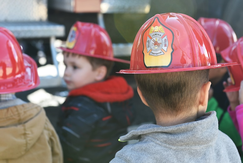 Children from the Crested Butte Child Development Center were given plastic fire helmets by the Buckley Fire Department Oct. 7, 2015, on Buckley Air Force Base, Colo. The fire department visited both CDCs on base to spread the word about Fire Prevention Week. For the visit, the children got to meet Sparky the Fire Dog, look at fire trucks, and take home coloring books. (U.S. Air Force photo by Airman 1st Class Samantha Meadors/Released)