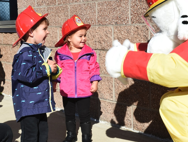 Children from the Crested Butte Child Development Center meet Sparky the Fire Dog Oct. 7, 2015, on Buckley Air Force Base, Colo. Sparky was part of a visit from the Buckley Fire Department to both CDCs on base to spread the word about Fire Prevention Week. The fire department also brought fire trucks for the children to look at, along with plastic fire helmets and coloring books for them to take home. (U.S. Air Force photo by Airman 1st Class Samantha Meadors/Released)