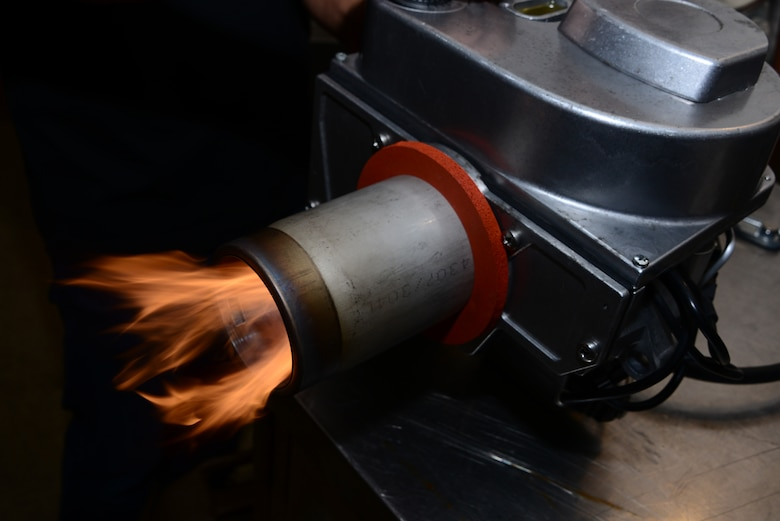 A Babington Airtronic burner functions during expeditionary kitchen training at Davis-Monthan Air Force Base, Ariz., Sept. 30, 2015. The Airmen that attended the training learned how to break down and reassemble the burner. (U.S. Air Force photo by Airman 1st Class Mya M. Crosby/Released)