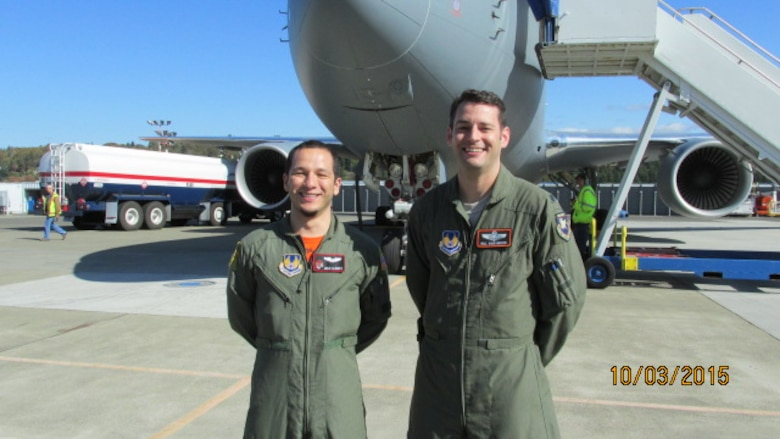 Capt. Julio Alvarez (left) and Lt. Col. James Quashnock stand in front EMD-1, the 767-2C that first flew late last year, at Boeing Field shortly after they were cleared to participate in flight testing. The Airmen, both experienced flight test pilots, will be responsible for military certification of Pegasus systems.