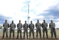 Members of the 509th Maintenance Squadron low observable shop stand in front of a restored Minuteman II Missile static display at Whiteman Air Force Base, Mo., Sept. 29, 2015. The low observable technicians were recognized by base leadership for the restoration project. (U.S. Air Force photo by Airman 1st Class Michaela R. Slanchik/Released)