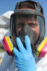 Tech. Sgt. Nicholas Fonzo, 509th Maintenance Squadron low observable technician, dons his respirator mask prior to performing maintenance on a Minuteman II Missile static display Sept. 1, 2015, at Whiteman Air Force Base, Mo. In addition to aircraft painting and other normal duties, low observable technicians perform cosmetic maintenance on static displays at Whiteman. (U.S. Air Force photo by Airman 1st Class Michaela R. Slanchik/Released)