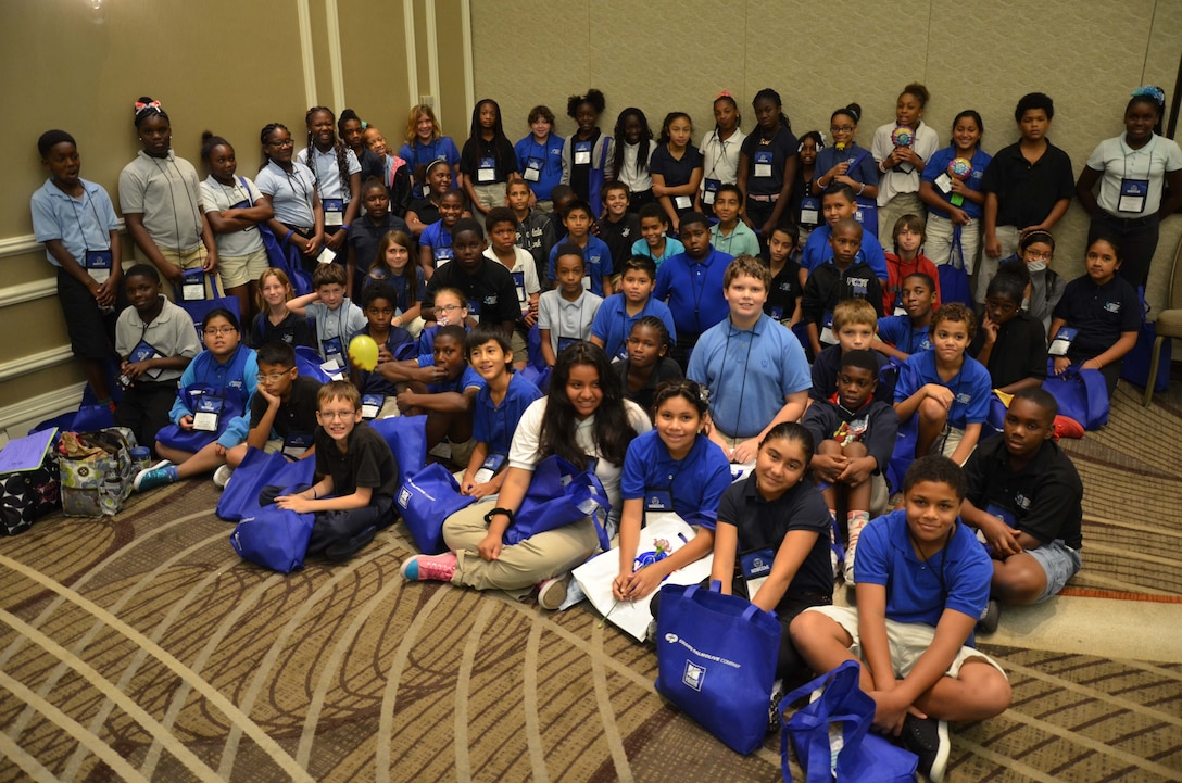 150925-F-SR919-005 –  Eighty-five students from Endeavour Elementary Magnet School in Cocoa, Fla., pose for a group photo after attending the National Organization for the Professional Advancement of Black Chemists and Chemical Engineers' (NOBBChE) Science Exhibition in Orlando Sept. 25, 2015.   The students were sponsored by the Air Force Technical Applications Center, Patrick AFB, Fla., as part of the center's STEM (science, technology, engineering and math) community outreach program. (U.S. Air Force photo by Susan A. Romano)