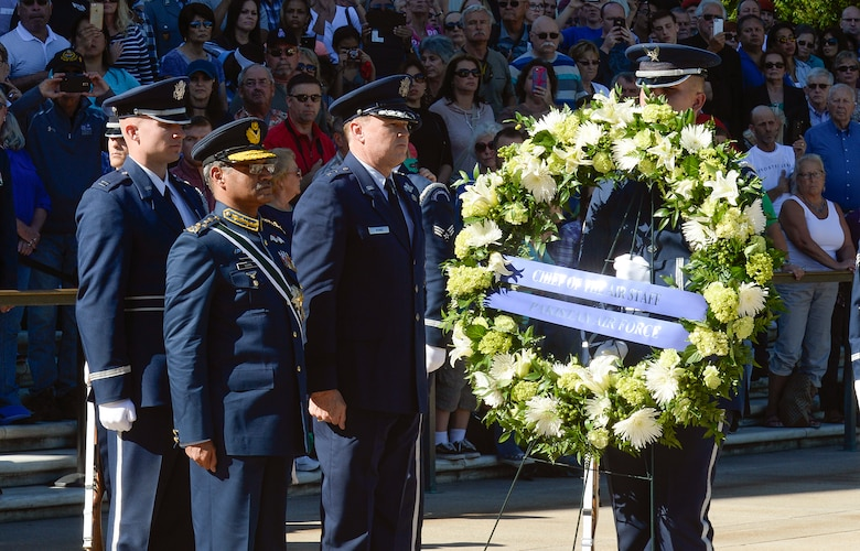 Air Chief Marshal Sohail Aman, Chief of Air Staff of the Pakistan Air Force, and Air Force District of Washington Commander Maj. Gen. Darryl Burke participate in a wreath laying ceremony at the Tomb of the Unknown Soldier at Arlington National Cemetery on Oct. 6, 2015. Distinguished visitors commonly pay formal respects to the sacrifice of America's veterans in foreign wars by placing a wreath before the Tomb. The Air Force District of Washington brings air, space and cyberspace capabilities to the joint team protecting the nation's capital, and supports local personnel and those serving worldwide. (Photo/ Andy Morataya)