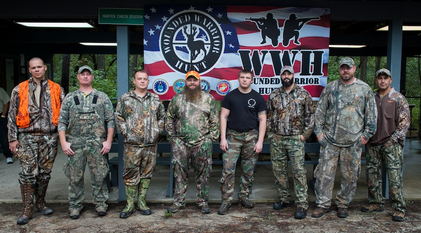 Wounded warriors participating in the 2015 Wounded Warrior Hunt gather for a group photo Oct. 2, 2015, at the hunter check station on Joint Base Charleston – Weapons Station, S.C. The Wounded Warrior project's purpose is to provide unique, direct programs and services to meet the needs of injured service members, help injured service members aid and assist each other and raise awareness and enlist the public's help in meeting the needs of injured service members. (U.S. Air Force photo/Airman 1st Class Clayton Cupit)
