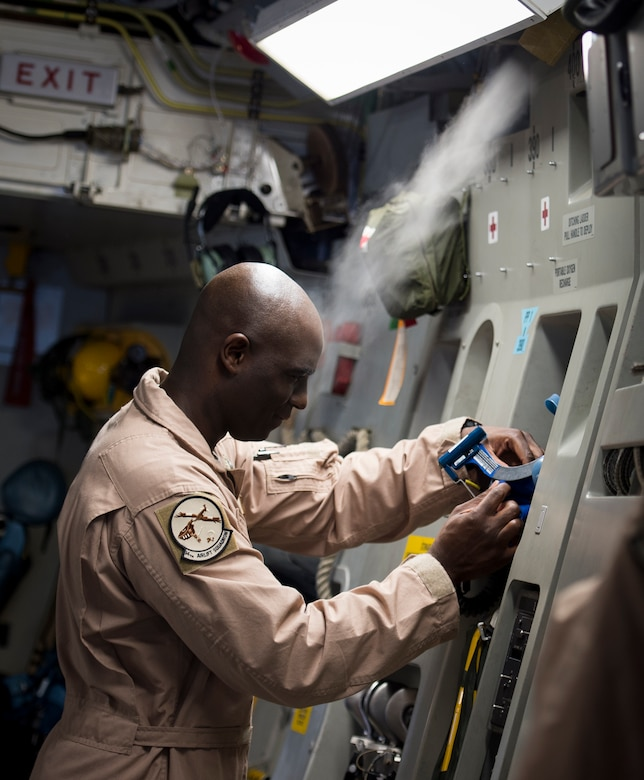 """Master Sgt. Michael Seaton, 14th Airlift Squadron loadmaster superintendent, performs pre-flight checks on equipment inside a C-17 Globemaster III Sept. 29, 2015, on the flightline at Joint Base Charleston – Air Base, S.C. Each year the Airlift/Tanker Association recognizes individuals who have demonstrated superior leadership, made outstanding contributions to the airlift/tanker mission and provided invaluable service to their civilian communities. Seaton was selected for the Air Mobility Command """"Loadmaster"""" General Robert """"Dutch"""" Huyser Award. (U.S. Air Force photo/Airman 1st Class Clayton Cupit)"""