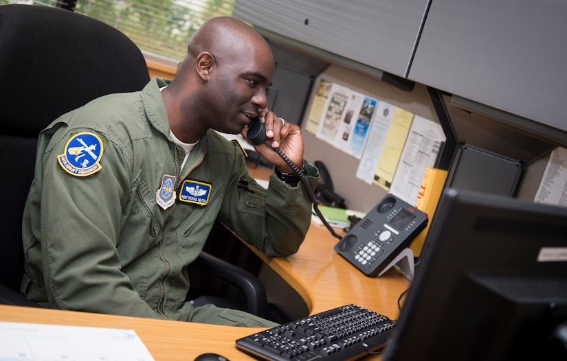 """Master Sgt. Michael Seaton, 14th Airlift Squadron loadmaster superintendent, talks on the phone in his office Sept. 25, 2015, at the 14th AS on Joint Base Charleston – Air Base, S.C. Each year the Airlift/Tanker Association recognizes individuals who have demonstrated superior leadership, made outstanding contributions to the airlift/tanker mission and provided invaluable service to their civilian communities. Seaton was selected for the Air Mobility Command """"Loadmaster"""" General Robert """"Dutch"""" Huyser Award. (U.S. Air Force photo/Airman 1st Class Clayton Cupit)"""