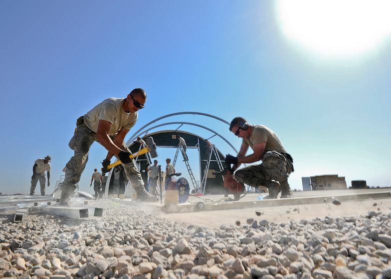 Staff Sgt. Adam Borjon, 435th Construction Training Squadron engineer system's operator (left), and Senior Airman Alen Turner, 435th CTS pavement and equipment operator, build structures Sept. 23, 2015 in support of personnel recovery operations at Diyarbakir Air Base, Turkey. The 435th Contingency Response Group deployed from Ramstein Air Base, Germany, in support of the U.S. Air Forces Central Command's staging aircraft and Airmen in southeast Turkey to enhance Coalition capabilities to support personnel recovery operations in Syria and Iraq. (U.S. Air Force photo by Airman Cory W. Bush/Released)