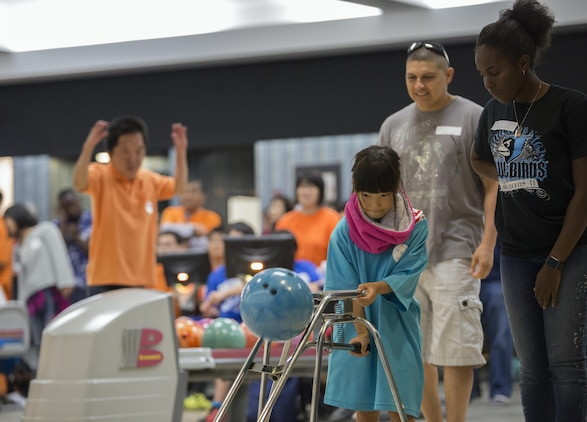 A Special Olympics athlete competes in a bowling competition during the Special Olympics Hiroshima at the Strike Zone Bowling Center at Marine Corps Air Station Iwakuni, Japan, Oct. 4, 2015. As the last event before the Olympians received their medals, the special Olympics maintained its inspirational tempo by promoting a competitive atmosphere, camaraderie and sportsmanship.