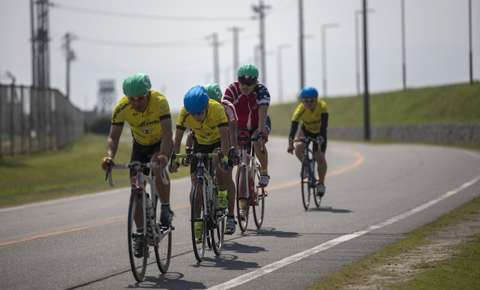 Cyclists race toward the finish line during the Special Olympics Hiroshima at Marine Corps Air Station Iwakuni, Japan, Oct. 4, 2015. This sporting program helps instill confidence, inspire competitors, and improve athlete health through the transformative power of sports.