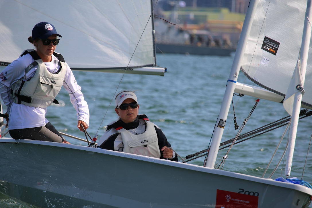 U.S. Women's Sailing team, with Navy Lt. Trisha Kutkiewicz (right) and Ensign Mary Hall (left) capture the gold medal in the 6th Conseil International du Sport Militaire (CISM), ouscoring Russia by one point for their first trip to the top of the podium since 2005. CISM Military World Games were held 2-11 October in Mungyeong, South Korea.