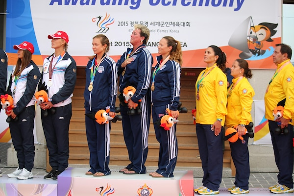 USA captures gold in the Women's Sailing two-person dinghy competition of the 6th Conseil International du Sport Militaire (CISM) in Mungyeong, South Korea 2-11 October.  U.S. Women from left to right: Navy Ensign Mary Hall (skipper); Ms. Sharkie Stielper (team captain) and Navy Lt. Trisha Kutkiewicz (crew). The U.S. took gold for the first time since 2005, outscoring Russia by one point.