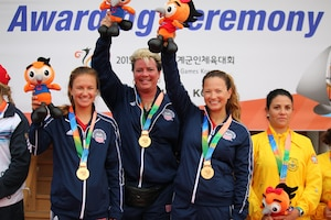 U.S. Women's Sailing Team capture the gold medal over Russia during the 6th Conseil International du Sport Militaire (CISM) Military World Games in Pohang, South Korea 2-11 October.  Skipper Navy Ensign Mary Hall (left) and crewmember Navy Lieutenant Trisha Kutkiewicz earned placed higher in 11 races, defeating Russia by one point.  The U.S. Women's Sailing team was the first official medal of the World Games for the U.S.