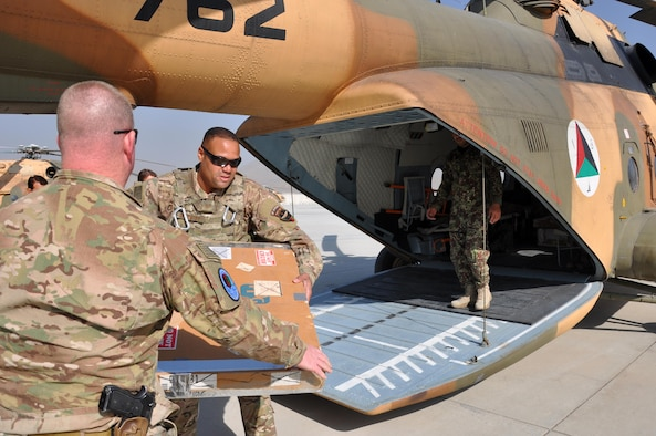 Tech. Sgt. Angel Gonzalez, C-130 maintenance supply liaison at Train, Advise, Assist Command – Air (TAAC-Air), loads aircraft parts and equipment onto an Afghan Air Force Mi-17 helicopter at Hamid Karzai International Airport in Kabul, Afghanistan, Oct. 5, 2015. Gonzalez conducted an annual inventory and found $1.7 million worth of parts identified as lost or missing, and he was flying them to Bagram Air Field, Afghanistan, to put them back in the U.S. Air Force inventory. (U.S. Air Force photo by Capt. Eydie Sakura/released)