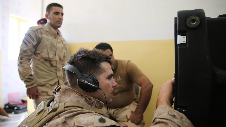 U.S. Marine Staff Sgt. Eric Alabiso, an information operations advisor with Task Force Al Asad, runs a diagnostic test on a Radio in a Box at Al Asad Air Base, Iraq, Sept. 28, 2015. The RIAB was provided by Iraq's Ministry of Defense through the Iraq Train and Equip Fund. The fund was established by Combined Joint Task Force – Operation Inherent Resolve, a part of the multinational coalition force that helps improve the Iraqi military's ability to fight against the Islamic State of Iraq and the Levant by providing training and advice to its soldiers and officers.