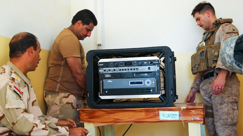 U.S. Marine Staff Sgt. Eric Alabiso, right, a military information operations advisor with Task Force Al Asad, helps an Iraqi soldier with the 7th Iraqi Army Division set up a Radio in a Box at Al Asad Air Base, Iraq, Sept. 28, 2015. The RIAB was provided by Iraq's Ministry of Defense through the Iraq Train and Equip Fund. The fund was established by Combined Joint Task Force – Operation Inherent Resolve, a part of the multinational coalition force that helps improve the Iraqi military's ability to fight against the Islamic State of Iraq and the Levant  by providing training and advice to its soldiers and officers.