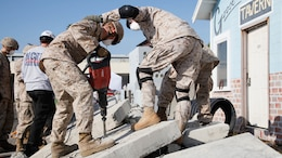 Marines cut through concrete slabs with a jackhammer during urban search and rescue training at Treasure Island, Oct. 7, 2015, as part of San Francisco Fleet Week 2015. The event featured demonstrations and hands-on training with tools commonly used for rescue missions during disaster relief.