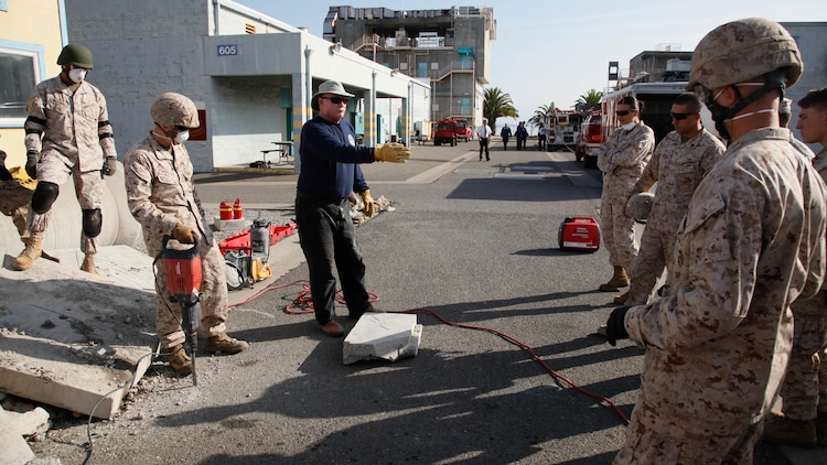 Marines, firefighters cut through training obstacles