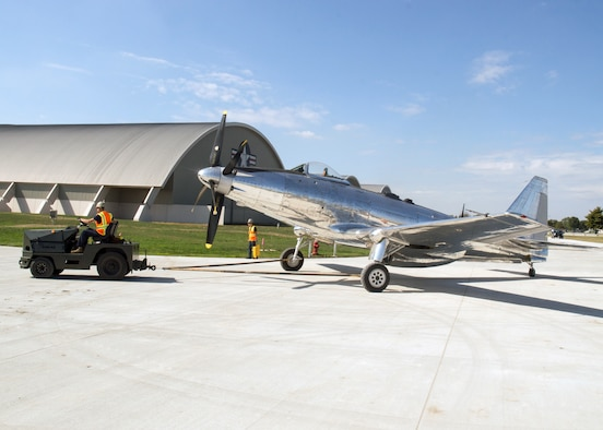 Restoration staff move the Fisher P-75A into the new fourth building at the National Museum of the U.S. Air Force on Oct. 7, 2015. (U.S. Air Force photo by Ken LaRock)