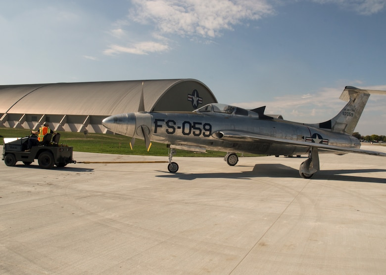 Restoration staff move the Republic XF-84H into the new fourth building at the National Museum of the U.S. Air Force on Oct. 7, 2015. (U.S. Air Force photo by Ken LaRock)