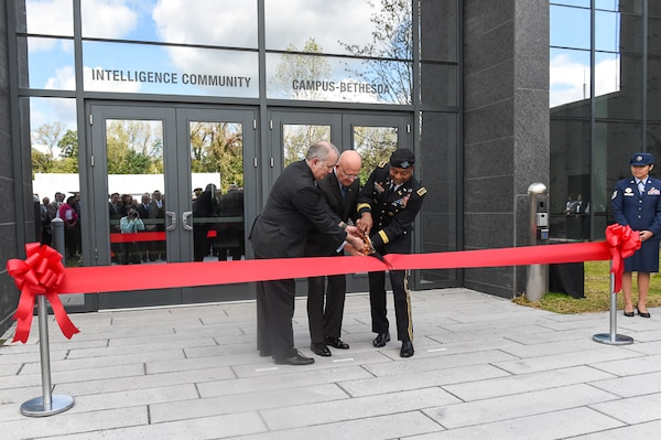 Douglas H. Wise, deputy director of the Defense Intelligence Agency, James R. Clapper, director of national intelligence, and Lt. Gen. Thomas P. Bostick, chief of engineers and commanding general of the U.S. Army Corps of Engineers, cut the ribbon during the opening of the Intelligence Community Campus-Bethesda, in Bethesda, Maryland, October 7, 2015.