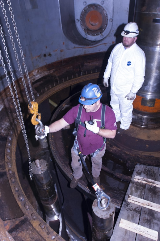A. J. Conley (Front), turbine mechanic with Voith Hydro, and his supervisor Kye Moss, remove a wicket gate from hydropower unit two in the power house at Center Hill Dam Oct. 7, 2015. The U.S. Army Corps of Engineers Nashville District is rehabbing all three units at the dam.