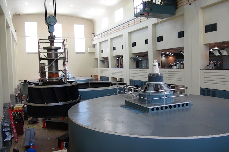 Work crews lift the turbine runner out of hydropower unit two in the power house at Center Hill Dam Oct. 7, 2015 as employees watch the operation from a viewpoint above the main floor. The U.S. Army Corps of Engineers Nashville District is rehabbing all three units at the dam.