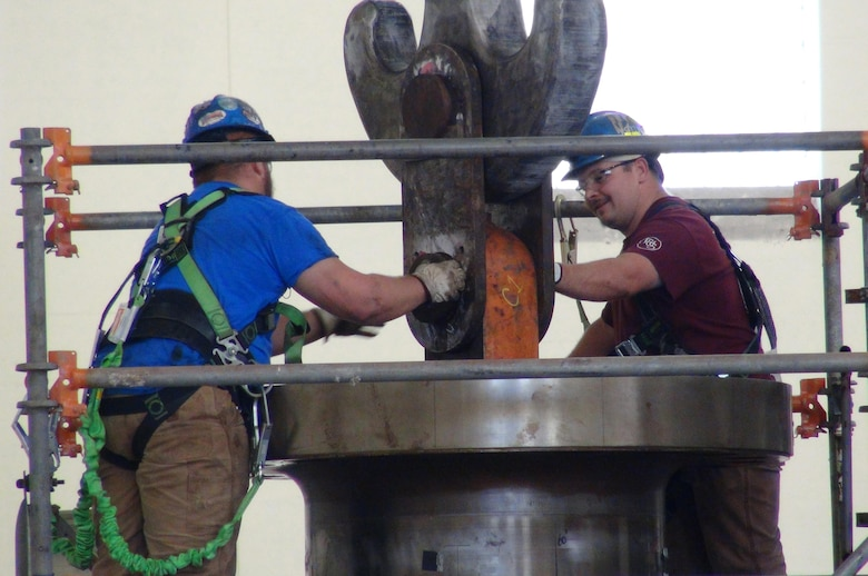 A. J. Conley (Right), turbine mechanic with Voith Hydro, and his supervisor Kye Moss, detach the crane from the turbine runner after its removal from hydropower unit two in the power house at Center Hill Dam Oct. 7, 2015. The U.S. Army Corps of Engineers Nashville District is rehabbing all three units at the dam.