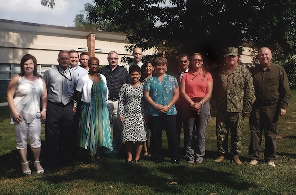 Members of the Joint Contingency Acquisition Support Office, part of Defense Logistics Agency Logistics Operations, pose for a photo before kicking off weeklong training for 24 new contingency contracting officers.