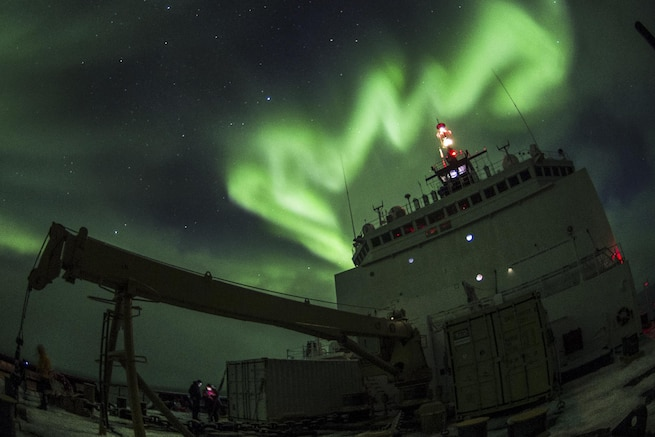 The aurora borealis are visible over the Coast Guard Cutter Healy in the Arctic Ocean, Oct. 4, 2015. The Healy is supporting the National Science Foundation-funded Arctic Geotraces project, part of an international effort to study the distribution of trace elements in the world's oceans. U.S. Coast Guard photo by Petty Officer 2nd Class Cory J. Mendenhall
