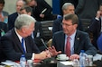 U.S. Defense Secretary Ash Carter speaks with British Defense Secretary Michael Fallon before the NATO defense ministers meeting in Brussels, Oct. 8, 2015. NATO photo