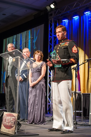 Staff Sgt. Andres Rodriguez gives his acceptance speech after being named the USO North Carolina Marine of the Year at the 2015 Annual Salute to Freedom Gala in Durham, N.C., Oct. 3, 2015. Congressman David Price, 4th District of NC presented each honoree with The U.S. flag flown over the Capitol in Washington DC.