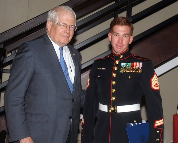 Staff Sgt. Andres Rodriguez receives his award for USO North Carolina Marine of the Year at the 2015 Annual Salute to Freedom Gala in Durham, N.C., Oct. 3, 2015. Congressman David Price, 4th District of NC presented each honoree with The U.S. flag flown over the Capitol in Washington DC.