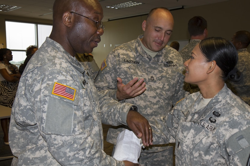 Soldiers in the Equal Opportunity Leaders Course are tasked to play a game called Star Power July 15, 2015, at Farmingdale, N.Y. This game allows the Soldiers to understand firsthand the effects that social perception has on society. The EOLC is designed to provide leaders at battalion and company levels the critical skills needed to assist commanders, military personnel and family members with all the matters concerning equality and diversity in the organization. (U.S. Army Reserve Photo by Spc. Stephanie Ramirez/ RELEASED)
