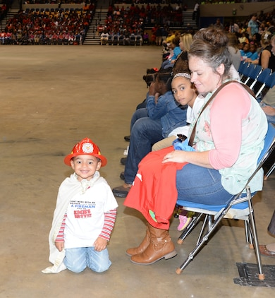 One of the youngest spectators attending the city's 21st annual Fire Safety Show dons his firefighter's head gear, T-shirt and cape at Albany's James H. Gray Civic Center, Oct 7. The little superhero was one of several hundred children, teachers, parents and safety officials, who poured into the Civic Center to participate in the Fire Prevention Week activities.