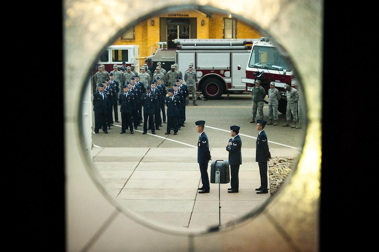 Cannon firefighters assigned to the 27th Special Operations Civil Engineering Squadron, prepare for the raising of the flag to half-staff during a ceremony dedicated to the fallen firefighters, Oct. 04, 2015 at Cannon Air Force Base, N.M. The ceremony was in observance of Bells Across America, a day dedicated to paying tribute to fellow firefighters who gave their life in the service of others. (U.S. Air Force photo/Tech. Sgt. Manuel J. Martinez)