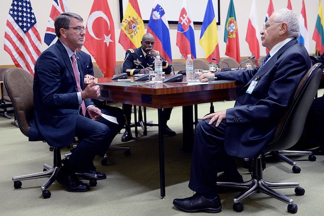 U.S. Defense Secretary Ash Carter speaks with Turkish Defense Minister Vecdi Gonul at NATO headquarters in Brussels, Oct. 8, 2015. Carter is on a five-day trip to Europe to attend the NATO Defense Ministerial in Brussels, and meet with counterparts in Spain, Italy and the United Kingdom. DoD photo by U.S. Army Sgt. 1st Class Clydell Kinchen