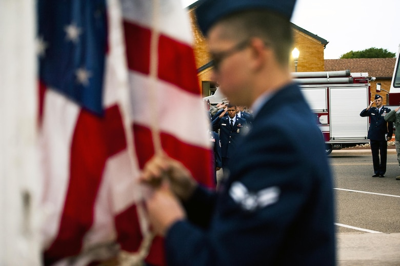 Cannon firefighters assigned to the 27th Special Operations Civil Engineering Squadron, salute as the U.S. Flag is raised to half-staff during a ceremony dedicated to the fallen fiirefighters, Oct. 04, 2015 at Cannon Air Force Base, N.M. The ceremony was in observance of Bells Across America, a day dedicated to paying tribute to fellow fiirefighters who gave their life in the service others. (U.S. Air Force photo/Tech. Sgt. Manuel J. Martinez)