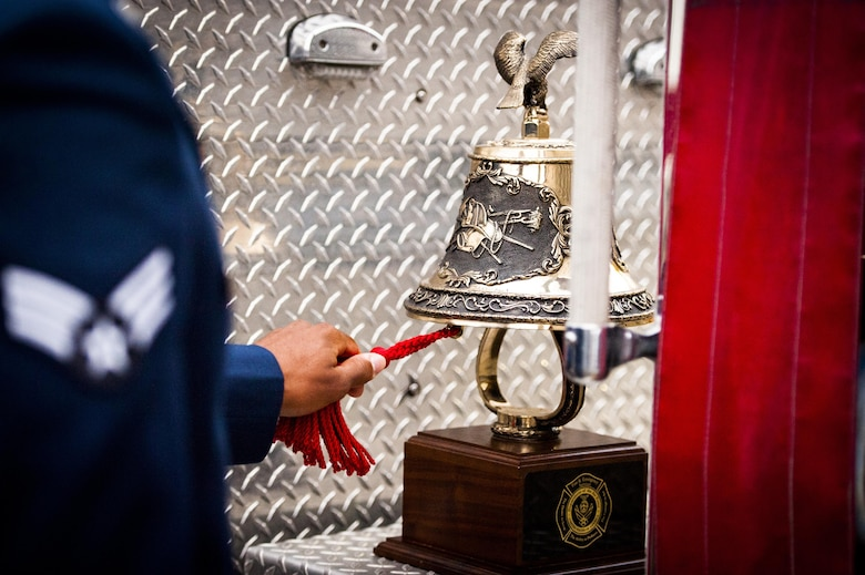 A Cannon firefighter assigned to the 27th Special Operations Civil Engineering Squadron, rings a symbolic bell during a ceremony dedicated to the fallen firefighters, Oct. 04, 2015 at Cannon Air Force Base, N.M. The ceremony was in observance of Bells Across America, a day dedicated to paying tribute to fellow firefighters who gave their life in the service of others. (U.S. Air Force photo/Tech. Sgt. Manuel J. Martinez)