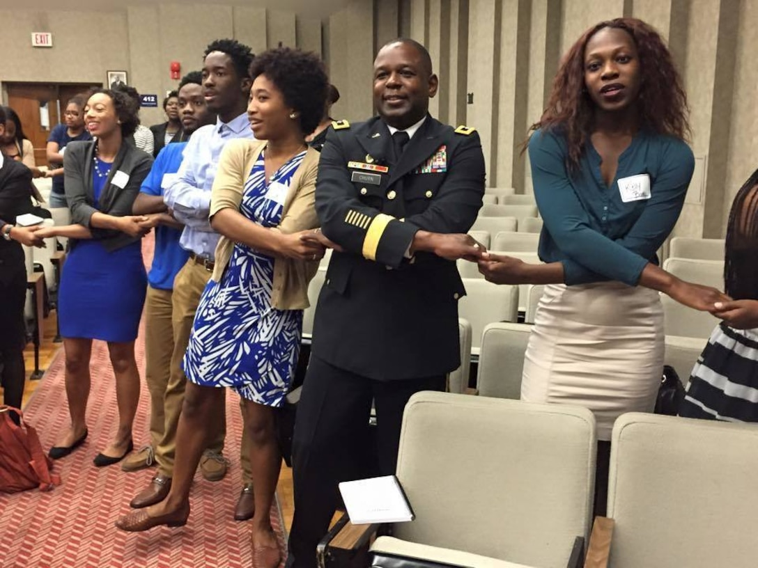 Maj. Gen. Phillip M. Churn, the commanding general for the 200th Military Police Command, joins the students at the Leadership Conference in the Howard University School of Law in Washington, as they sing their alma mater to conclude the conference Aug. 29, 2015.  The conference focused on challenging graduate and undergraduate students to become leaders and change agents in society, Maj. Gen. Churn delivered the closing address at the ceremony.