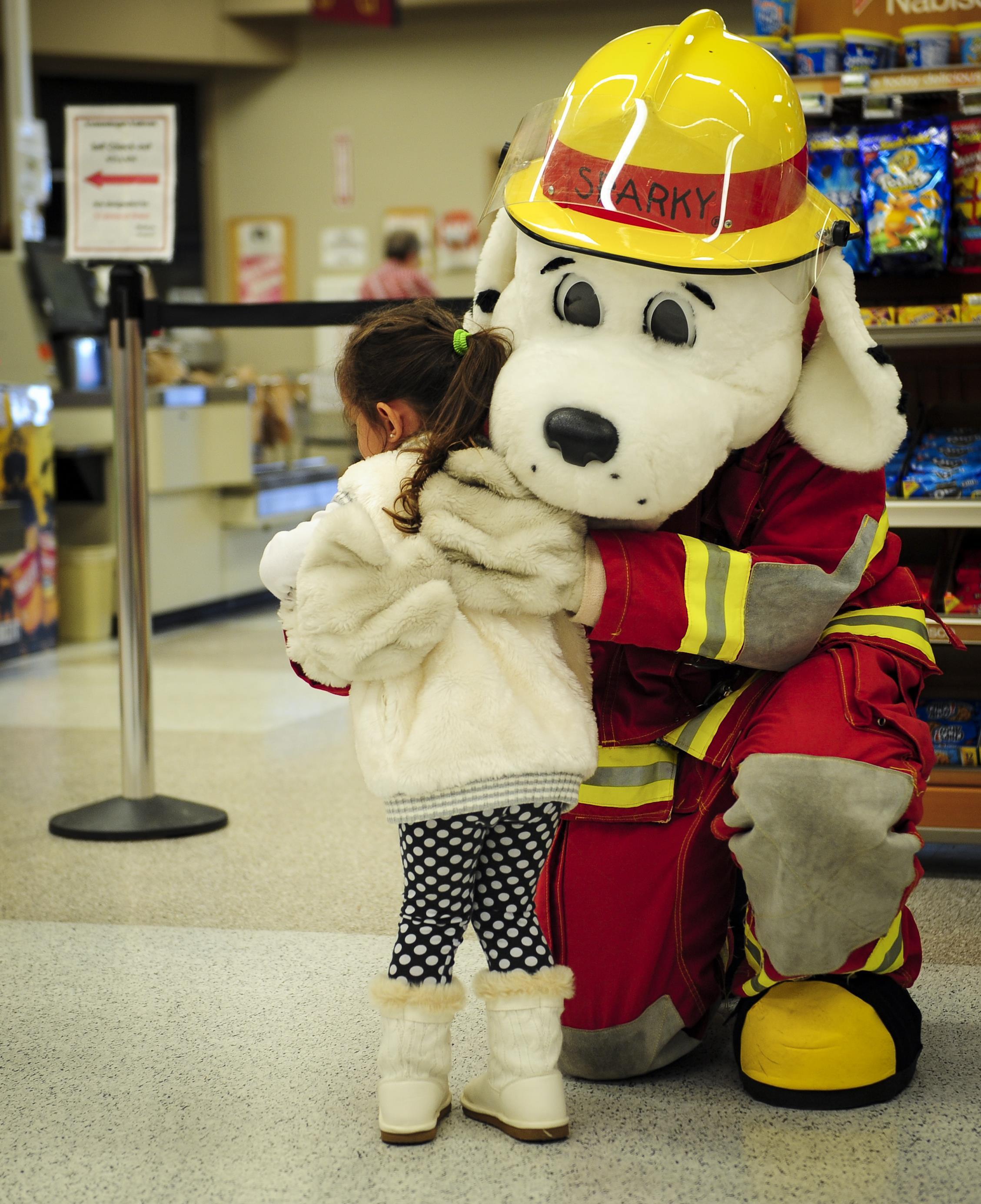Sparky The Fire Dog National Prevention Association Spokesdog Hugs A Girl During