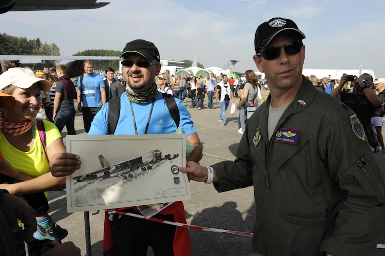 U.S. Air Force Lt. Col. Chris Anderson, the 307th Operations Support Squadron commander, shows a drawing of a B-52 Stratofortress at the NATO Days 2015 air show at Ostrava, Czech Republic. An attendee brought the drawing to have the aircrew autograph it. The air show was attended by over 225,000 people from Sept. 19-20. (Photo courtesy of U.S. Air Force Capt. Kerry Baker/Released)