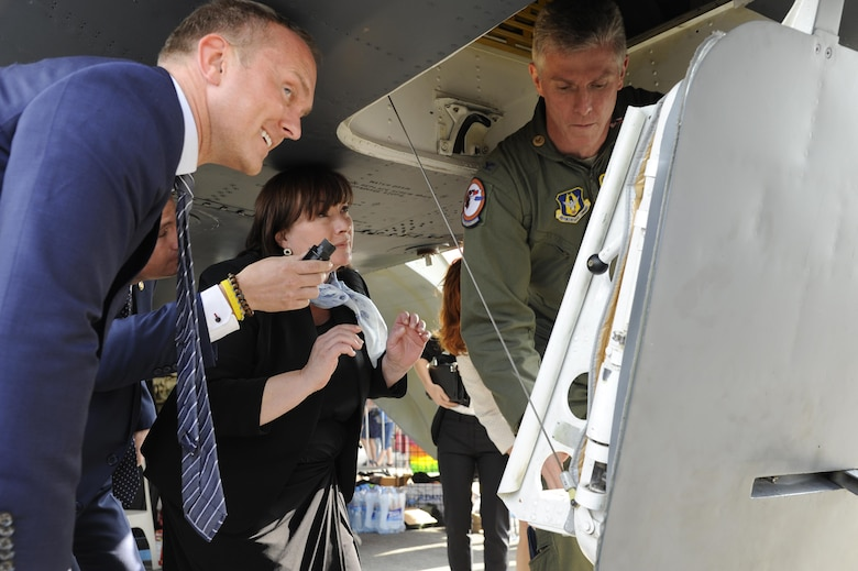 U.S. Air Force Col. James Morriss, 307th Bomb Wing vice commander, opens the hatch to a B-52 Stratofortress to allow the First Lady of the Czech Republic, Mrs. Ivana Zemanova, to tour the inside of the bomber. The B-52 was part of the NATO Days 2015 air show and was showcased during Sept. 19-20 at Ostrava, Czech Republic. (Photo courtesy of U.S. Air Force Capt. Kerry Baker/Released)