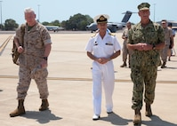 U.S. Navy Adm. Scott H. Swift, commander, U.S. Pacific Fleet, right, walks with U.S. Marine Corps Lt. Gen. John A. Toolan, commanding general, U.S. Marine Corps Forces, Pacific, left, and Australian CDRE Brenton Smyth, commander, Northern Command, Australian Defence Force, center, Oct. 4 after arriving at Royal Australian Air Force Base Darwin, Darwin, Australia. Swift and Toolan visited the Marines of Marine Rotational Force – Darwin. The rotational deployment in Darwin enables Marines to more effectively train, exercise, and operate with partners, by enhancing regional security and building capacity to respond more rapidly to natural disasters and crises throughout that region.