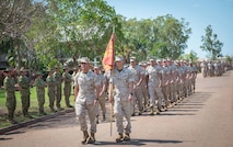 U.S. Marines with 1st Battalion, 4th Marine Regiment, Marine Rotational Force - Darwin march through applauding Australian soldiers with 1st Brigade, Australian Army Oct. 5 at the end of a farewell ceremony hosted by 1 BDE at Robertson Barracks, Northern Territory, Australia. U.S. Marine Corps Maj. Gen. Simcock and Australian Brig. Mick Ryan congratulated the Marines on their hard work and the amount of effort they've shown throughout their time participating in training exercises, performing community services and immersing in Australian culture. The rotational deployment of U.S. Marines in Australia affords an unprecedented combined training opportunity with our allies and improves interoperability between our forces. Simcock is the commanding general of 3rd Marine Division, III Marine Expeditionary Force and Ryan is the commander of 1 BDE.