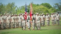 The U.S. Marines Corps color guard with 1st Battalion, 4th Marine Regiment, Marine Rotational Force - Darwin stands in formation Oct. 5 during a farewell ceremony hosted by 1st Brigade, Australian Army, at Robertson Barracks, Northern Territory, Australia. U.S. Marine Corps Maj. Gen. Richard Simcock and Australian Brig. Mick Ryan congratulated the Marines on their hard work and the amount of effort they've shown throughout their time participating in training exercises, performing community services and immersing in Australian culture. The rotational deployment of U.S. Marines in Australia affords an unprecedented combined training opportunity with our allies and improves interoperability between our forces. Simcock is the commanding general of 3rd Marine Division, III Marine Expeditionary Force and Ryan is the commander of 1 BDE.