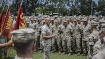 """""""The reason behind the presence of U.S. Marines out here is because you are the force of choice,"""" stated U.S. Marine Corps Maj. Gen. Richard Simcock to 1st Battalion, 4th Marine Regiment, Marine Rotational Force – Darwin, Oct. 6 at Robertson Barracks, Palmerston, Australia. """"In your six months here you've accomplished more than any other Marine Expeditionary Unit can claim."""" Simcock and Sgt. Maj. Vincent Santiago congratulated the Marines on their hard work and the amount of effort they've shown throughout their time with 1st Brigade, Australian Army while participating in training exercises, performing community services and immersing in Australian culture. The rotational deployment of U.S. Marines in Australia affords an unprecedented combined training opportunity with our allies and improves interoperability between our forces. Simcock and Santiago are the commanding general and sergeant major of 3rd Marine Division, III Marine Expeditionary Force."""