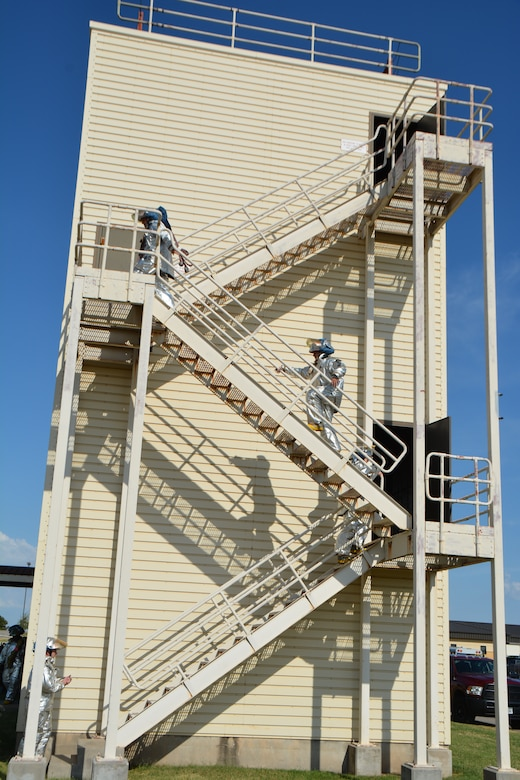 Firefighters from the 507th Civil Engineer Squadron climb the steps of the fire training tower for 56 minutes during the annual 9/11 fire climb Sept. 13, 2015 at Tinker Air Force Base, Okla. This marks the 6th year that the Reservists have commemorated the victims and workers of 9/11 attacks by climbing the fire training tower for 56 minutes, which is the time it took for the south tower to collapse after being struck by an airliner. (U.S. Air Force photo/Maj. Jon Quinlan)