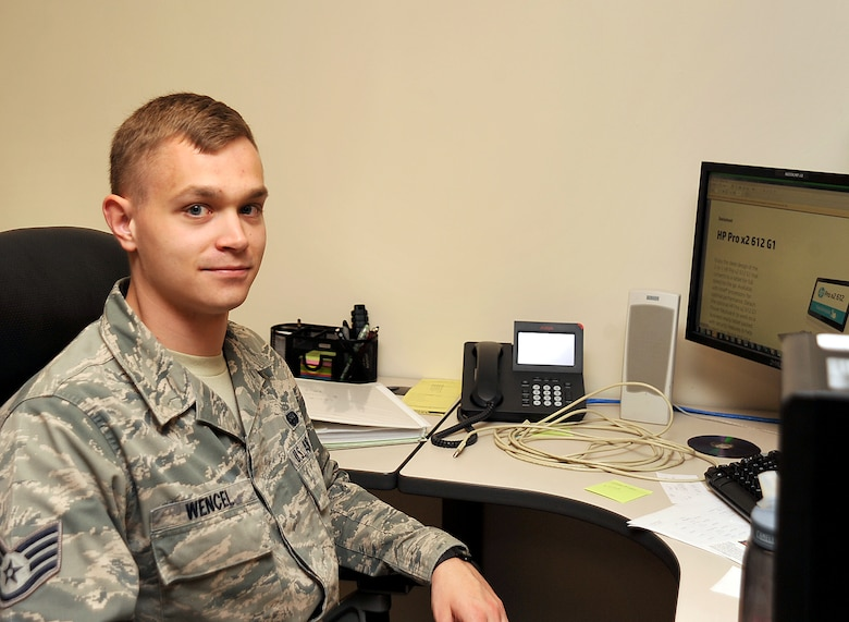 Staff Sgt. Steven Wencel, 319th Communications Squadron client systems supervisor, pauses from his duties for a photo on Grand Forks Air Force Base, North Dakota, Oct. 8, 2015. Wencel was selected Warrior of the Week for the second week of October 2015. (U.S. Air Force Photo by Airman 1st Class Bonnie Grantham/released)