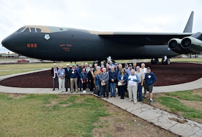 """Members of the 461st Bomb Wing and their spouses pose for a picture Oct. 1 in front of """"Early Riser,"""" a B-52 in Tinker's Maj. Charles B. Hall Memorial Air Park. The retirees, who meet every two years, were treated to a tour of Tinker and the B-52 maintenance facility.  (Air Force photo by Kelly White/Released)"""